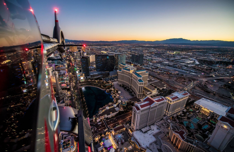 Helicopter Flying Over The Las Vegas Strip At Sunset